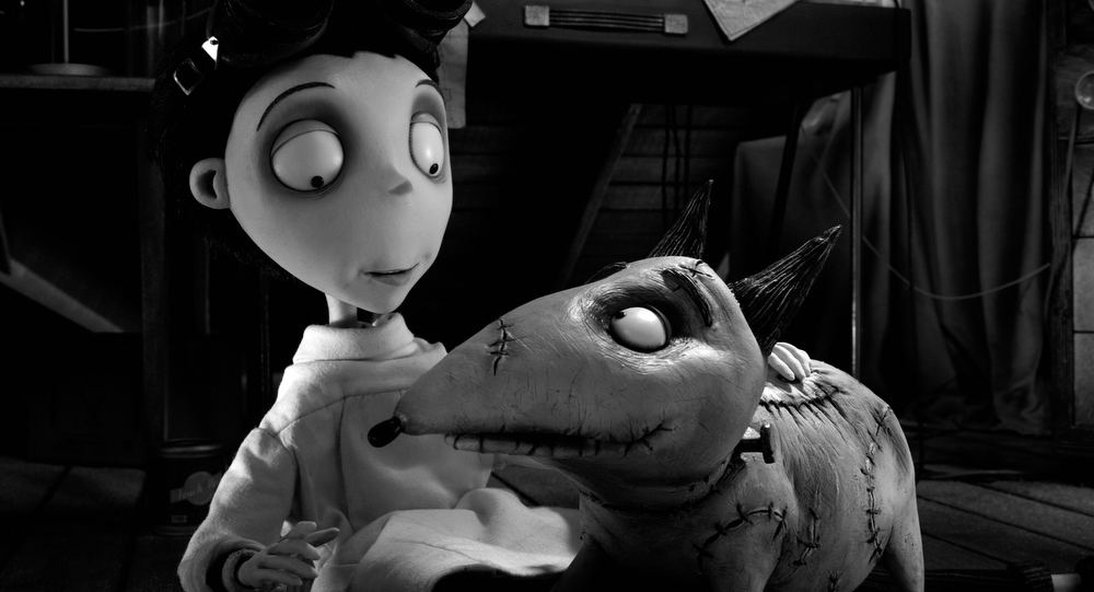 Description of . This film image released by Disney shows Victor Frankenstein, voiced by Charlie Tahan, with Sparky, in a scene from
