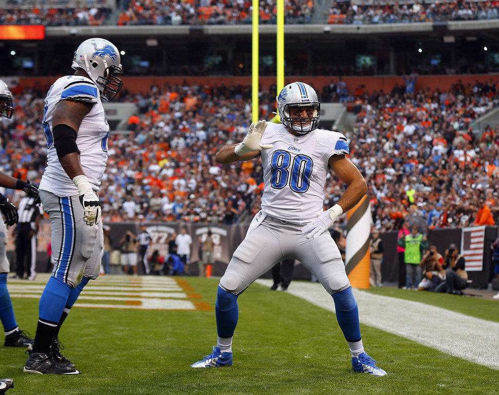 . Tight end Joseph Fauria #80 of the Detroit Lions celebrates after scoring a touchdown with tackle Corey Hilliard #78 against the Cleveland Browns at FirstEnergy Stadium on October 13, 2013 in Cleveland, Ohio.  (Photo by Matt Sullivan/Getty Images)