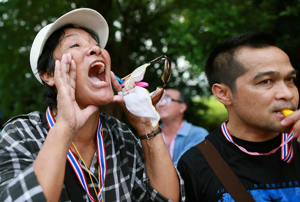 . Anti-government protesters shout slogans while gathering outside the Interior Ministry in Bangkok, Thailand, Tuesday, Nov. 26, 2013.  (AP Photo/Wason Wnnichakorn)
