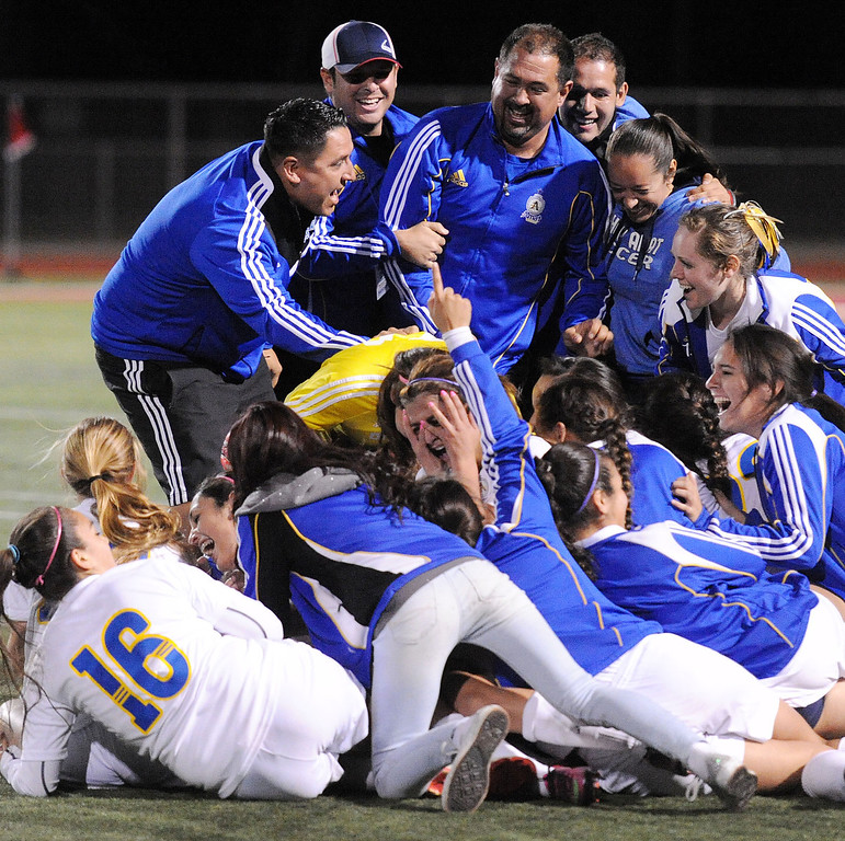 . 3-2-13 VXAMAT-POLY-14-WL (Will Lester/Staff Photographer) Bishop Amat players and coaches celebrate their Division 3 title after defeating Pasadena Poly 4-2 Saturday night. Bishop Amat defeats Pasadena Poly 4-2 Saturday March 2, 2013 in the 2013 Division 3 CIF-Southern Section Girls Soccer Championship at Corona High School.