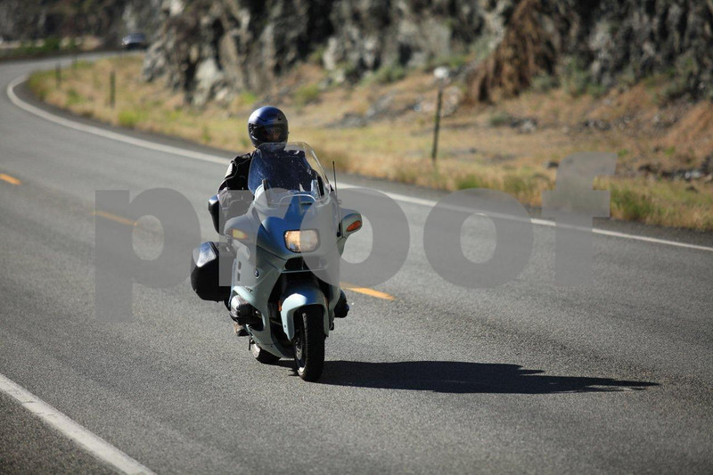 BMW rider going down that lonesome highway where life is good.