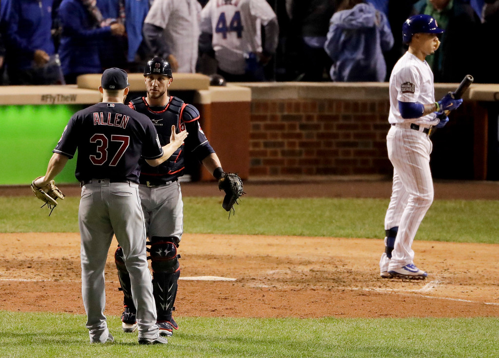 . Cleveland Indians catcher Yan Gomes, center, celebrates with relief pitcher Cody Allen after Chicago Cubs\' Javier Baez maked the final out in Game 3 of the Major League Baseball World Series Friday, Oct. 28, 2016, in Chicago. The Indians won 1-0 to take a 2-1 lead in the series. (AP Photo/Charlie Riedel)