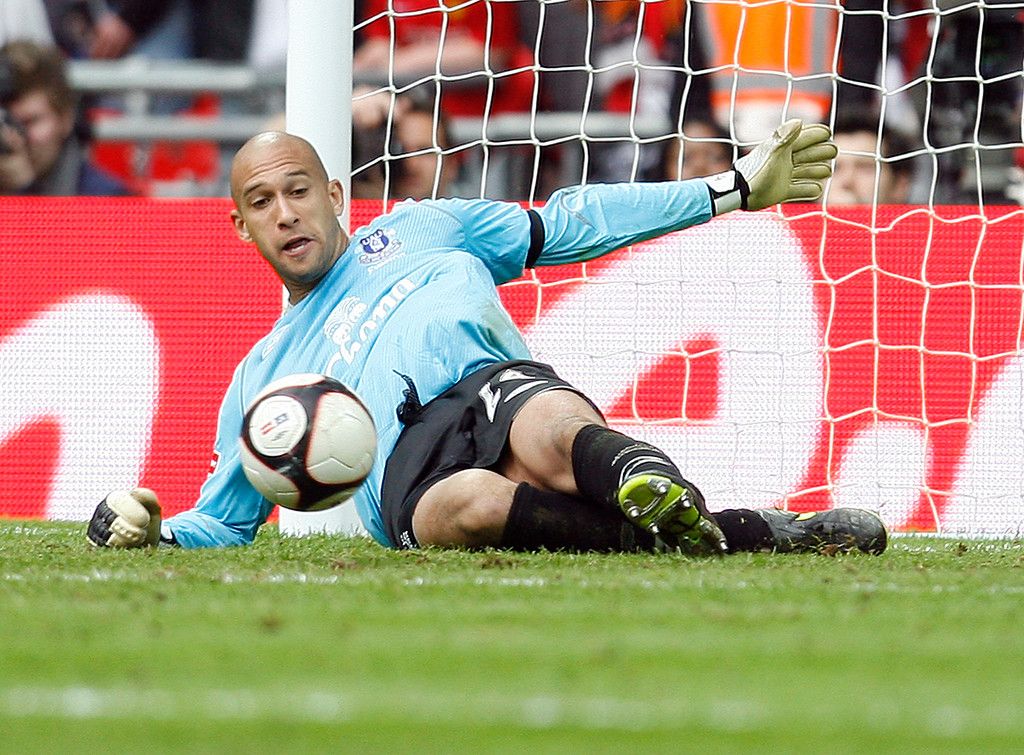 . In this April 19, 2009 file photo, Everton\'s Tim Howard saves a shot from Manchester United\'s Dimitar Berbatov during the penalty shoot out for their FA Cup semi-final soccer match at Wembley Stadium, London. Howard says an FA Cup final win with Everton on Saturday would feel even better than the one he enjoyed with Manchester United five years ago.. (AP Photo/Paul Thomas, File)
