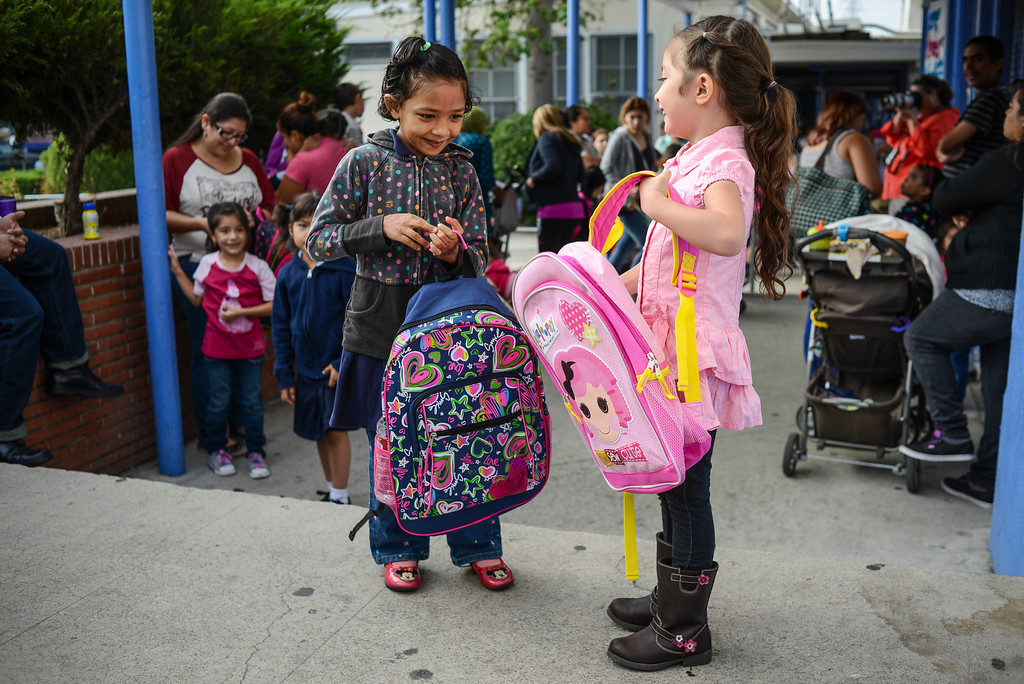 . Best friends Rabona Rahim, 5, and Katelyn Marinero, 5, compare backpacks before the start of their first day of kindergarten at Fair Avenue school in North Hollywood.   Tuesday is the first day of school for the Los Angeles Unified School District. Photo by David Crane/Los Angeles Daily News