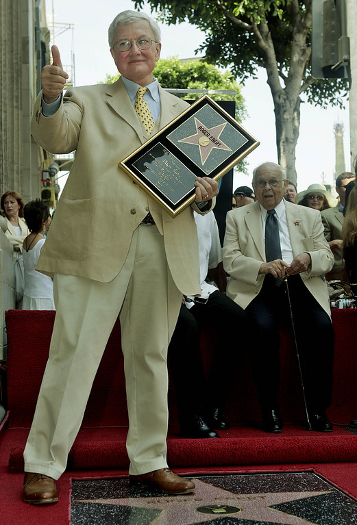. Film critic Roger Ebert poses for photographers Thursday, June 23, 2005, in the Hollywood section of Los Angeles. Ebert was honored Thursday with a star on the Hollywood Walk of Fame. (AP Photo/Ric Francis)