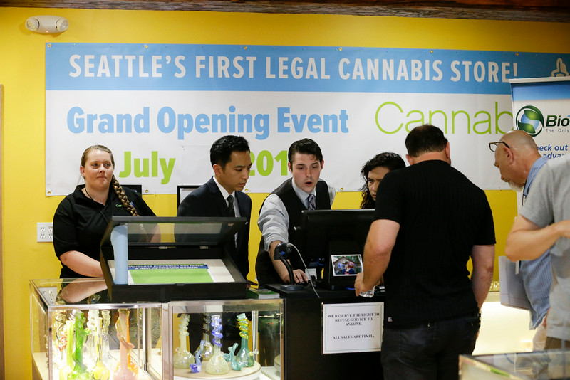. Employees prepare for opening day at the Cannabis City retail marijuana store on July 8, 2014 in Seattle, Washington. Cannabis City was the first retail marijuana store to open in Seattle today and one of the first group now operating in Washington state, nearly a year and a half after the state\'s voters chose to legalize marijuana for recreational use.  (Pool photo by Elaine Thompson/AP)