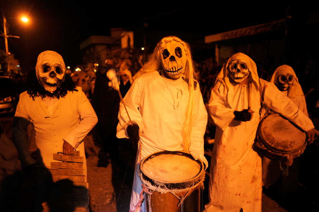 """. Young revellers take part in a parade called \""""La Calabiuza\"""" on November 1, 2012, on the eve of the Day of the Dead in Tonacatepeque, 20 kms (13 miles) north of San Salvador.  During the celebration, the residents of Tonacatepeque, originally an indigeneus community, recall the characters of the mythology of Cuscatlan --pre-Columbian west and central regions of El Salvador-- and their dead relatives.    Jose CABEZAS/AFP/Getty Images"""