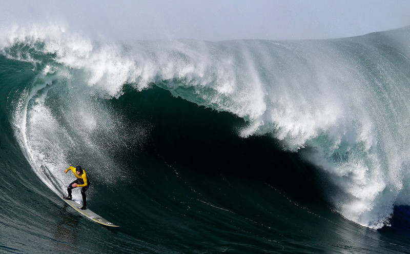 . Greg Long competes during the third heat of the Mavericks Surf Competition in Half Moon Bay, Calif., Sunday, Jan. 20, 2013. (AP Photo/Marcio Jose Sanchez)