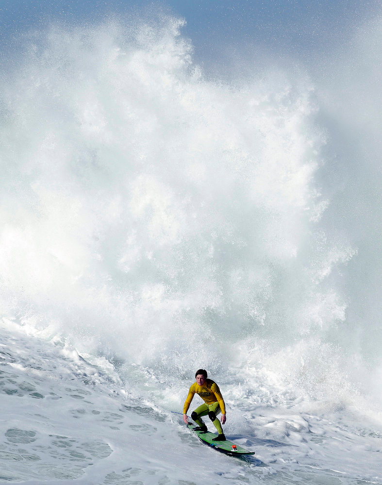 . Colin Dwyer competes during heat 4 of the Mavericks Invitational big wave surf contest in Half Moon Bay, Calif., Sunday, Jan. 20, 2013. (AP Photo/Marcio Jose Sanchez)