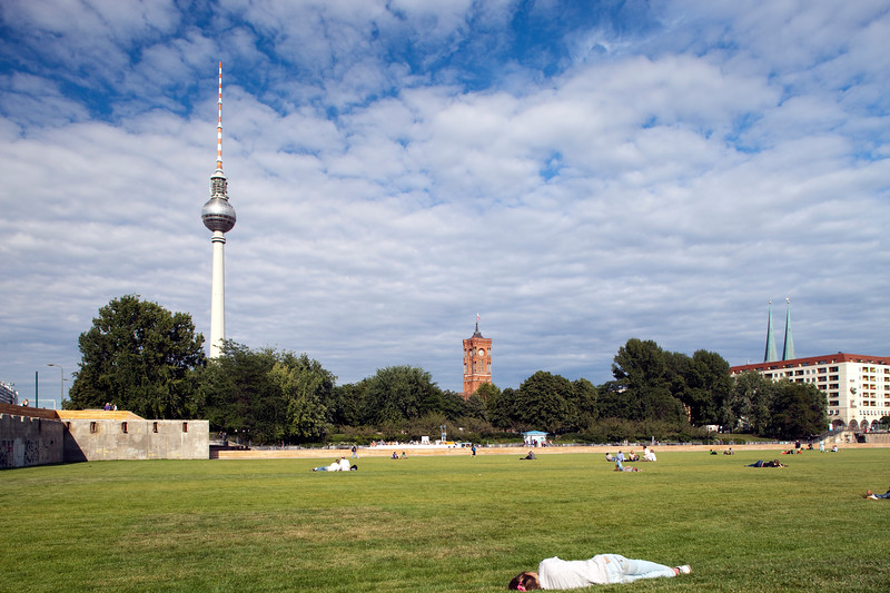 People sunbathing at Schlossplatz, Berlin, Germany