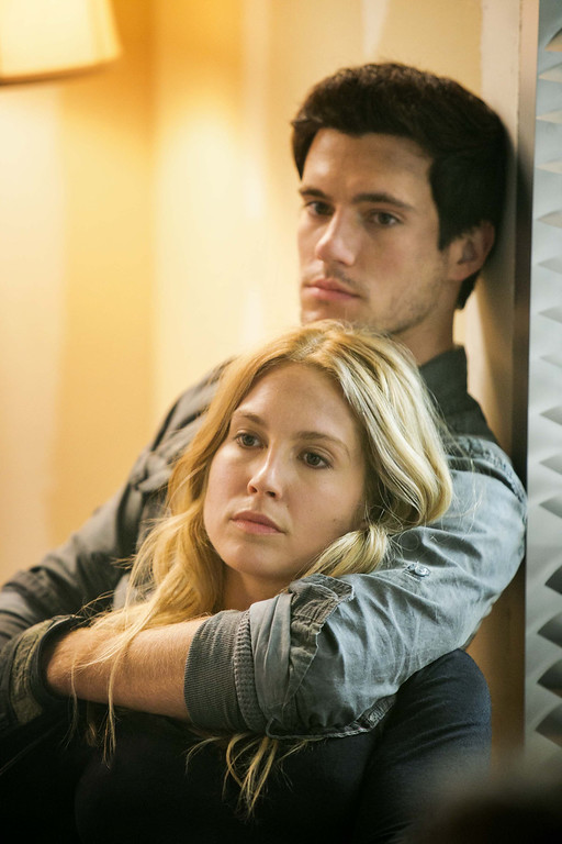 . Hal (Drew Roy) holds Maggie (Sarah Carter) as they await the arrival of his baby sister. Photo Credit: James Dittiger