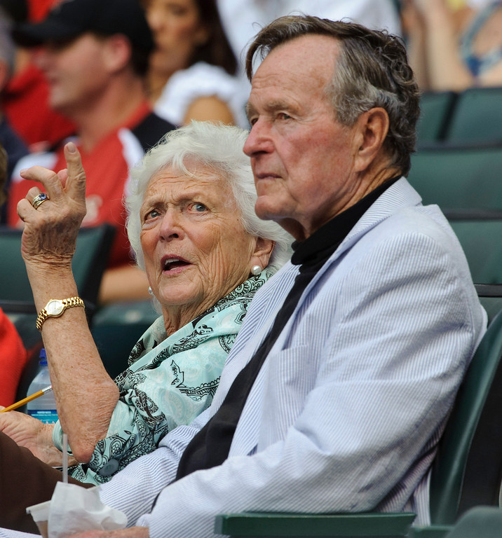 . Barbara Bush talks with former President George H.W. Bush during the fourth inning of an MLB baseball game between the Florida Marlins and Houston Astros Friday, April 8, 2011, in Houston. (AP Photo/Dave Einsel)