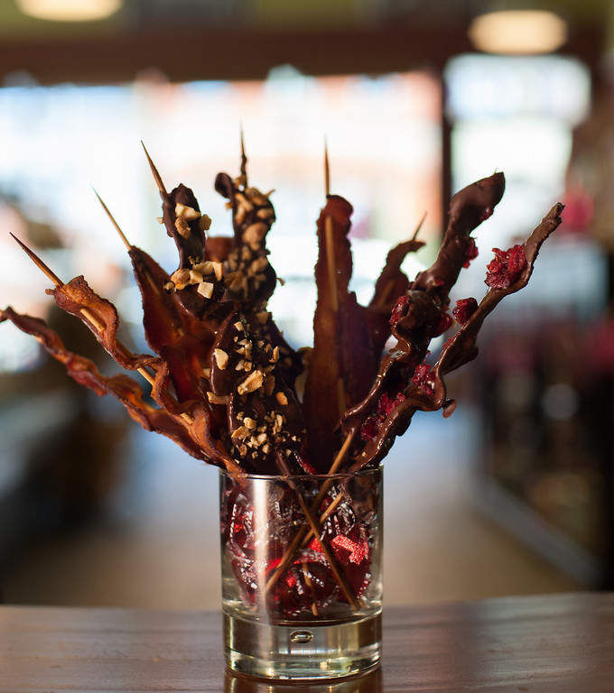 ". Emma Currie\'s \""bacon bouquet\"" is shown at the Market on Main on Tuesday, Feb. 11, 2014. (Sun photo by Holly Mahaffey/@hollymahaffey)"