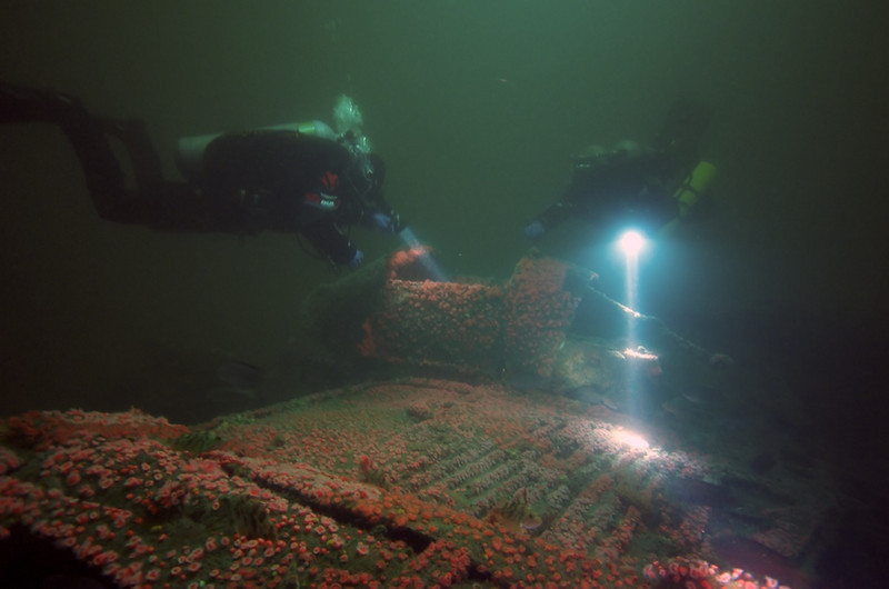 """Nick Ambrose P38 Bomber April 27, 2008 San Diego, California Nikon D300, 15mm, ambient light. """"Two divers inspect the cockpit and rear gun emplacement"""""""