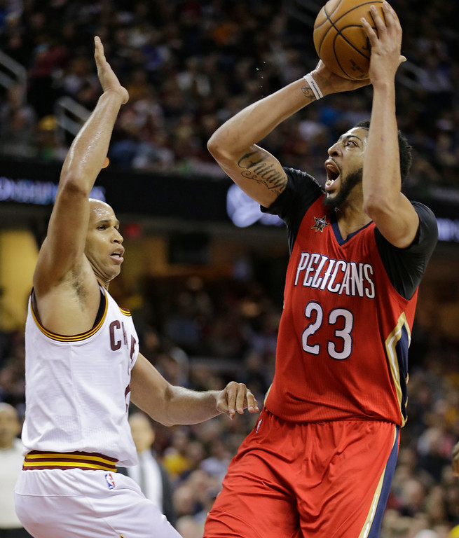 . New Orleans Pelicans\' Anthony Davis (23) shoots against Cleveland Cavaliers\' Richard Jefferson (24) in the second half of an NBA basketball game, Monday, Jan. 2, 2017, in Cleveland. (AP Photo/Tony Dejak)