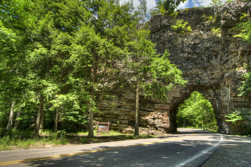 "Known locally as the ""Shortest Tunnel in the World"", this hole was drilled through the rock in 1901 by the Beaver Dam Railway Company, at the Backbone Rock Recreation Area, located in Tennessee near Damascus, VA on Friday, June 14, 2013. Copyright 2013 Jason Barnette"