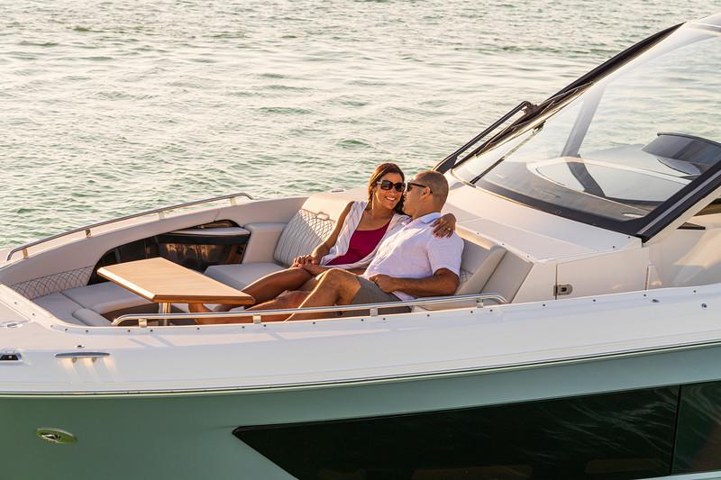 2021-Sundancer-370-Outboard-DAO370-lifestyle-bow-couple-table-05859.jpg