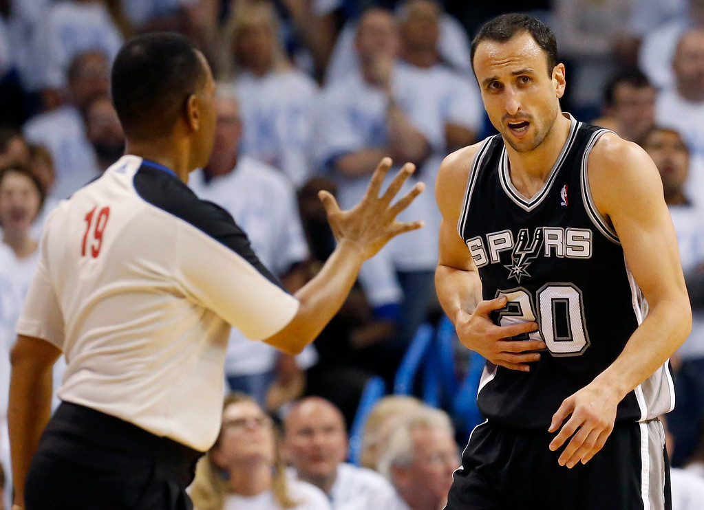 . San Antonio Spurs guard Manu Ginobili (20) recovers as referee James Capers (19) steps in during the second half against the Oklahoma City Thunder at Game 6 of the Western Conference finals NBA basketball playoff series in Oklahoma City, Saturday, May 31, 2014. (AP Photo/Sue Ogrocki)