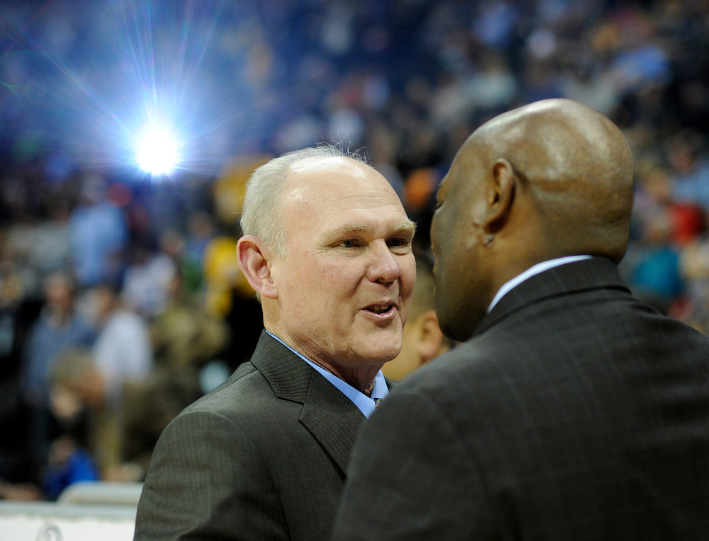 . DENVER, CO. - MARCH 22: Denver coach George Karl greeted Kings coach Keith Smart before the game. The Denver Nuggets defeated the Sacramento Kings 101-95 Saturday night, March 23, 2013 at the Pepsi Center. The Nuggets extended its longest winning streak since joining the NBA to 15 games with the win over the Kings. (Photo By Karl Gehring/The Denver Post)
