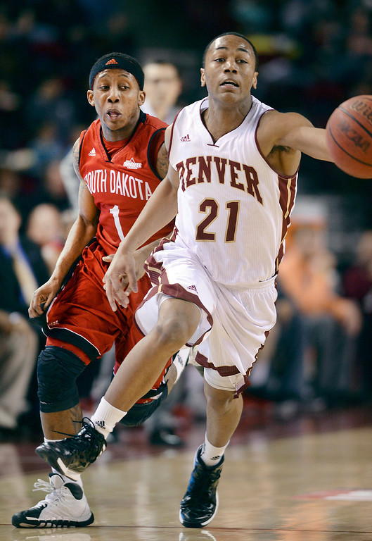 . DENVER, CO. - FEBRUARY 8, 2014: Denver guard Bryant Rucker (21) beat South Dakota guard Trey Norris (1) to a loose ball in the second half. The University of Denver defeated South Dakota 75-67 Saturday evening, February 8, 2014. Photo By Karl Gehring/The Denver Post