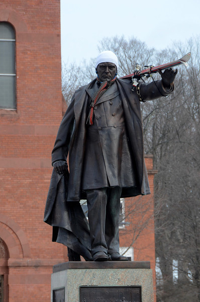 McKinley Statue with skis and hat-030314
