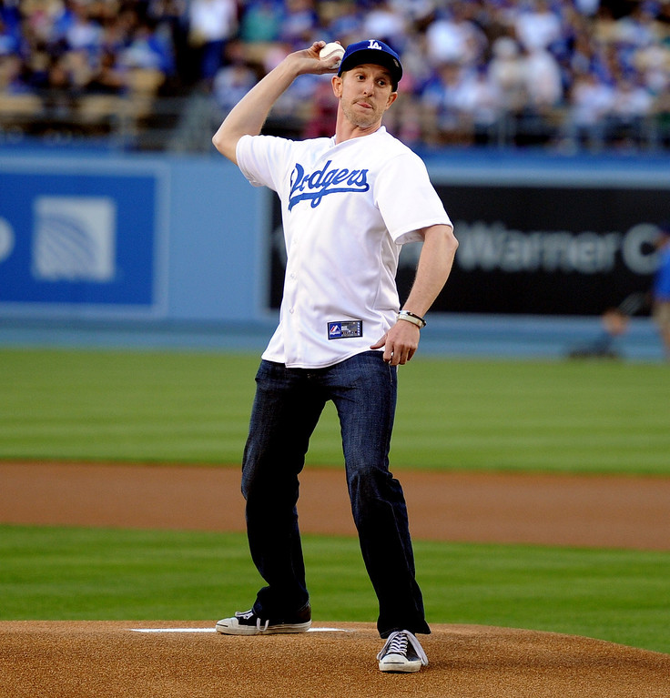. Indy car driver Charlie Kimball throws out the ceremonial pitch prior to a baseball game between the San Diego Padres and the Los Angeles Dodgers on Wednesday, April 17, 2013 in Los Angeles.   (Keith Birmingham/Pasadena Star-News)