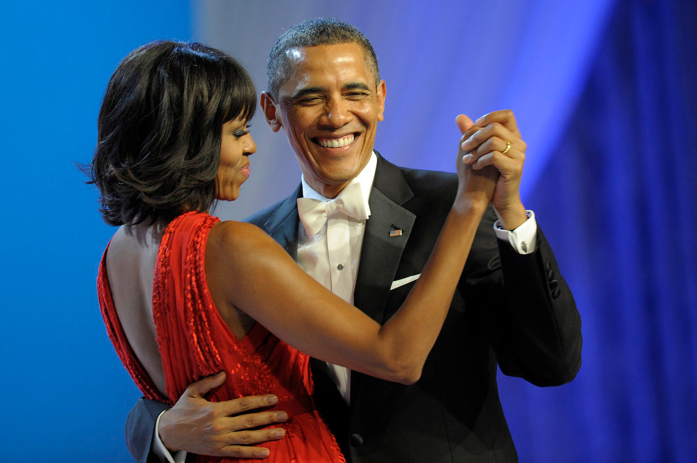 Description of . President Barack Obama dances with first lady Michelle Obama during The Inaugural Ball at the Washignton convention center during the 57th Presidential Inauguration in Washington, Monday, Jan. 21, 2013. (AP Photo/Cliff Owen)