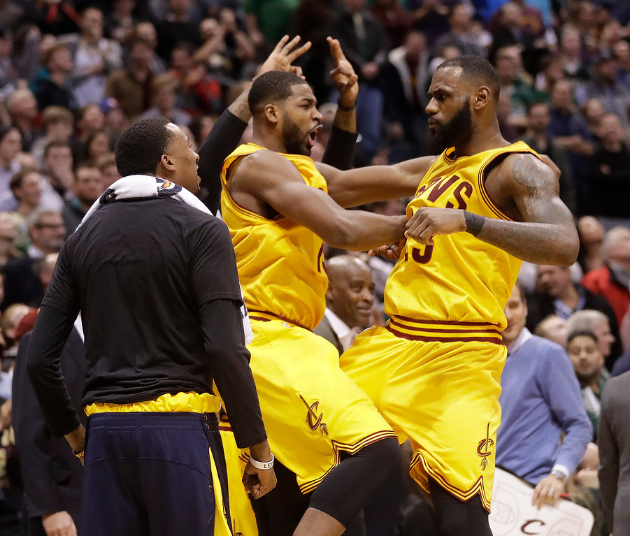 . Cleveland Cavaliers\' LeBron James is congratulated by teammate Tristan Thompson after making a three-point basket during overtimeof an NBA basketball game against the Milwaukee Bucks Tuesday, Dec. 20, 2016, in Milwaukee. The Cavaliers won 114-108. (AP Photo/Morry Gash)
