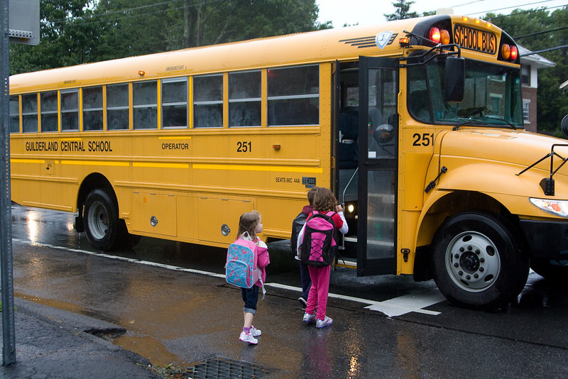 Getting on the bus for her first bus ride to school