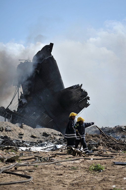 . AMISOM firefighters attempt to stop the fire at the site of an airplane crash in Mogadishu,  on August 9, 2013. AU UN IST PHOTO / TOBIN  JONES/AFP/Getty Images