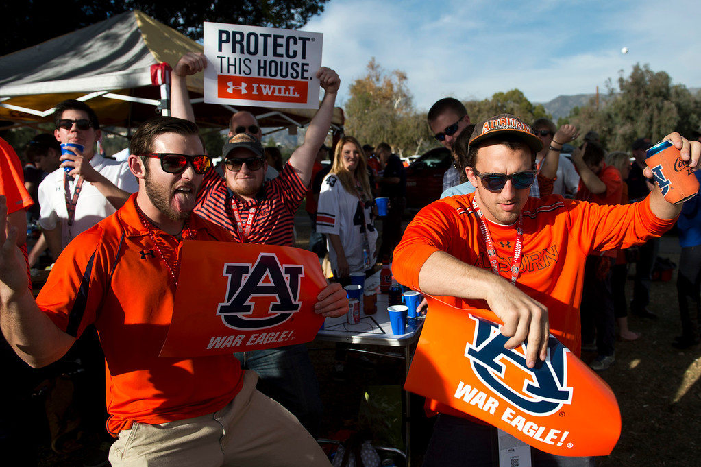 . Auburn fans dance in the parking lot before the BCS National Championship game at the Rose Bowl in Pasadena Calif. on Monday, Jan. 6, 2014. (Watchara Phomicinda/ Pasadena Star-News)