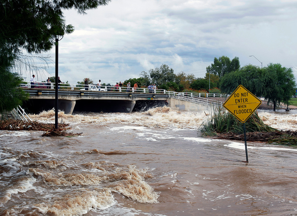 . Floodwaters surge Monday, Sept. 8, 2014, in Scottsdale, Ariz. (AP Photo/Rick Scuteri)
