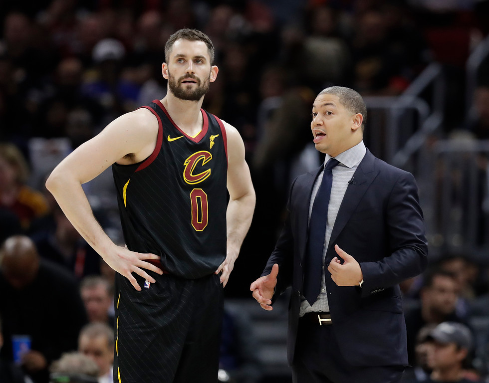 . Cleveland Cavaliers coach Tyronn Lue talks with Kevin Love during the second half in Game 4 against the Golden State Warriors in basketball\'s NBA Finals, Friday, June 8, 2018, in Cleveland. (AP Photo/Tony Dejak)