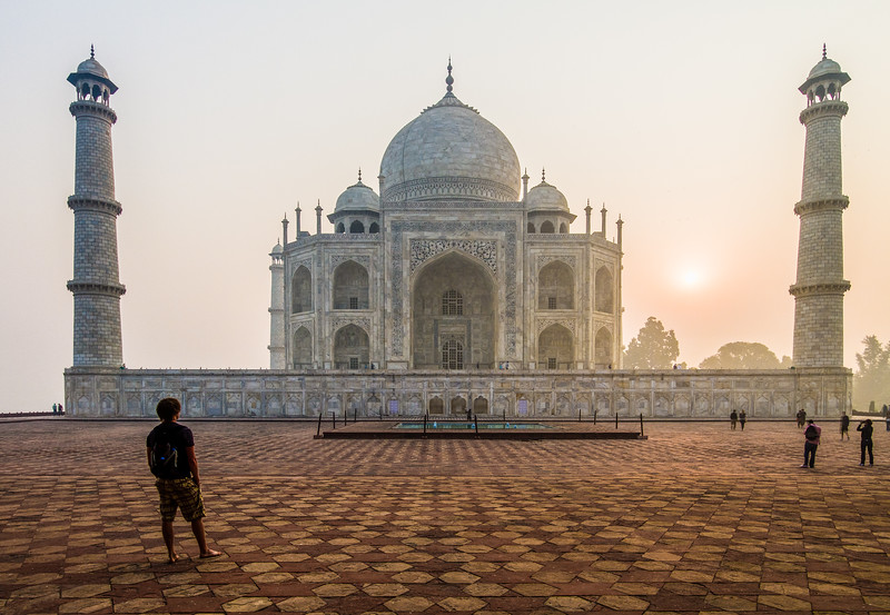 A Man Stands Before The Taj Mahal As The Sun Comes Up Behind It, Agra, India, Asia
