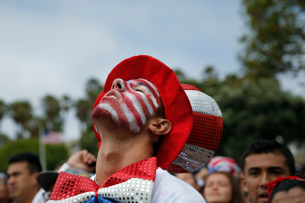 . Matt Clayton, 19, reacts while watching the World Cup soccer match between the United States and Belgium at a viewing party on Tuesday, July 1, 2014, in Redondo Beach, Calif. Belgium defeated the USA 2-1 in extra time. (AP Photo/Jae C. Hong)