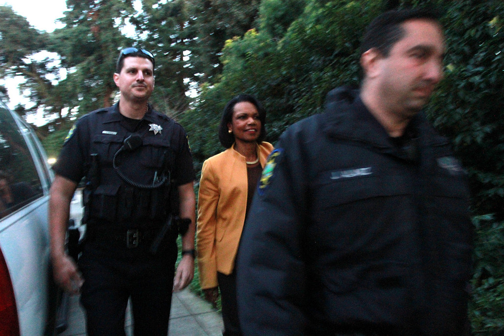 ". Condoleezza Rice is escorted by police officers to the Palo Alto home of Facebook CEO Mark Zukerberg to attend a campaign fundraiser for New Jersey Republican Gov. Chris Christie on Wednesday, Feb. 13, 2013. About 40 protesters rallied in front of the home, saying they objected to Christie�s visit because of his efforts to strip funding from Planned Parenthood and other women�s reproductive health care programs. Protester and Palo Alto resident Cheryl Lilienstein said she wondered whether Zuckerberg had any idea what Planned Parenthood means for women\'s health or what Christie�s stances are. ""I hope he\'s just confused,\"" she said. Zuckerberg and wife Priscilla Chan first got to know Christie after donating $100 million to struggling Newark, N.J., schools two years ago, according to a Facebook spokeswoman.   (Kirstina Sangsahachart/ Daily News)"