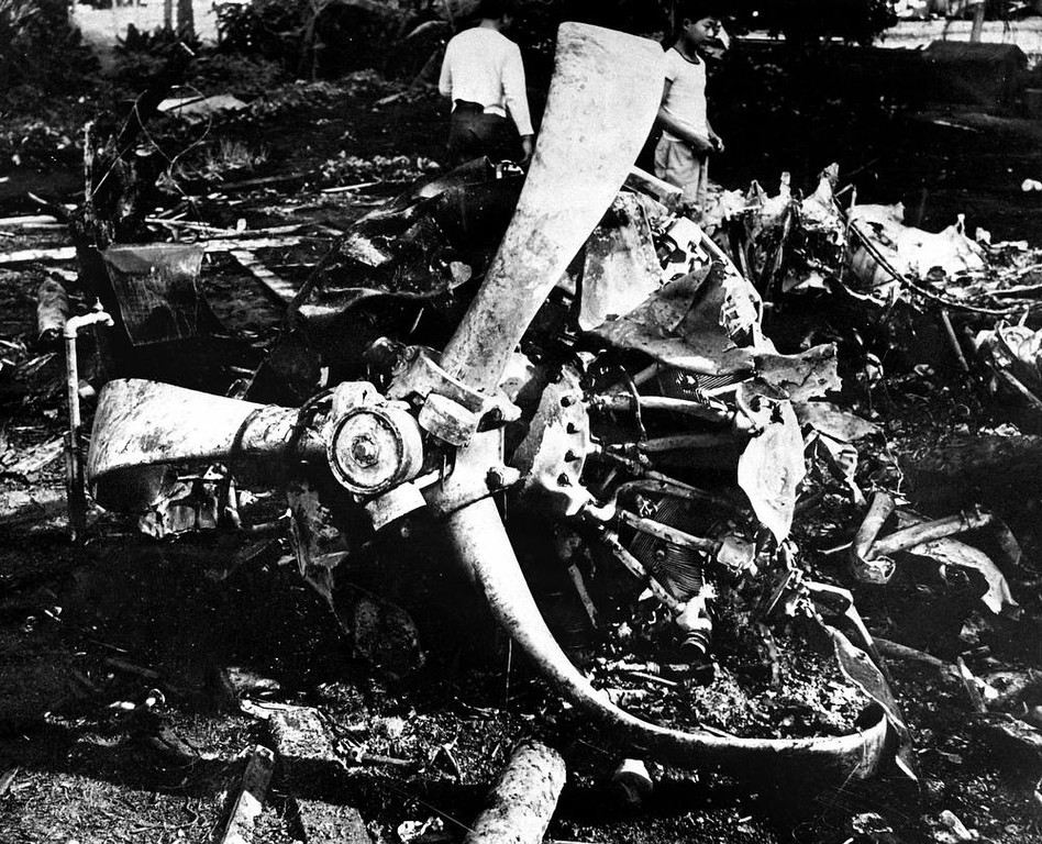 . Youths inspect the wreckage of a Japanese bomber, Dec. 17, 1941 brought down by a United States P-40 plane during the Dec 7, 1941 attack on Oahu, Hawaii. (AP Photo)