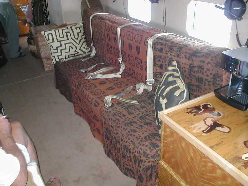 This bench folds up into bunk beds. The side tables have feature wood inlay with African animals.
