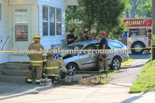 7/3/17 - Jackson car vs. house, 171 W High St