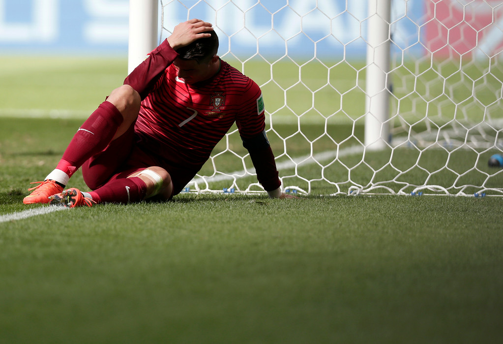 . Portugal\'s Cristiano Ronaldo reacts after he missed a chance to score during the group G World Cup soccer match between Portugal and Ghana at the Estadio Nacional in Brasilia, Brazil, Thursday, June 26, 2014. Ronaldo\'s first goal of the World Cup earned Portugal a 2-1 win over Ghana but couldn\'t prevent his team being eliminated from the tournament along with the Africans on Thursday. (AP Photo/Marcio Jose Sanchez)
