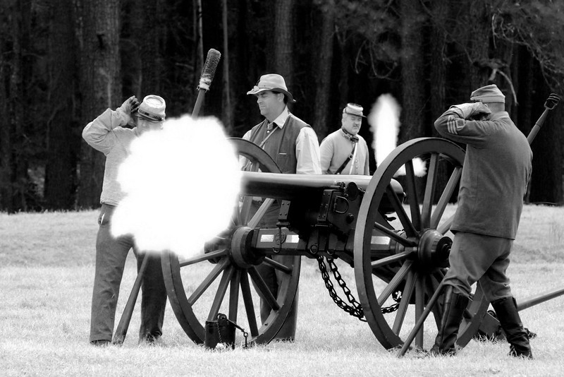 Confederate artillery reenactors fire a Parrot Rifle across the battlefield. The Skirmish at Gamble's Hotel happened on March 5, 1885 when 500 federal soldiers, under the command of Reuben Williams of the 12th Indiana Infantry, marched into Florence to destroy the railroad depot but were met by Confederate soldiers backed up with 400 militia. The reenactment, held by the 23rd South Carolina Infantry, was held at the Rankin Plantation in Florence, South Carolina on Saturday, March 5, 2011. Photo Copyright 2011 Jason Barnette