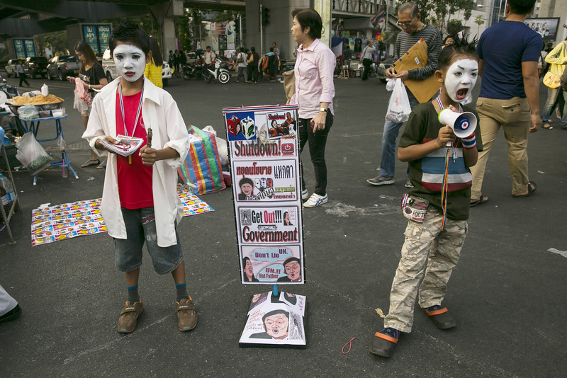 """. A Young protesters give a street performance while attending a rally on the fourth day of the \""""Bangkok Shutdown\"""" on January 16, 2014 in Bangkok, Thailand. Fear of more violence and instability as the anti-government protesters move forward in an attempt to shutdown Bangkok by blocking major intersections in the heart of the city in their long running campaign to oust the government of Prime Minister Yingluck Shinawatra. Thailand\'s political crisis has continued for months with elections going ahead on February 2. (Photo by Paula Bronstein/Getty Images)"""