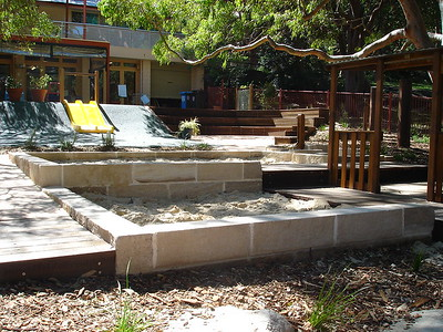 sandpit with sandstone block retaining