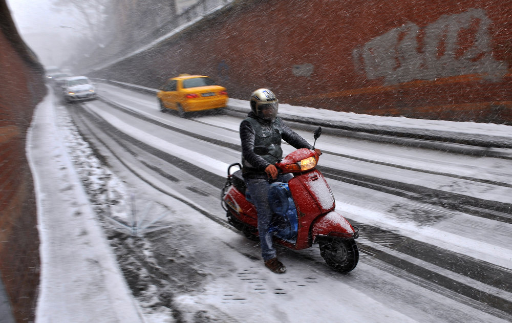 Description of . Snow falls during a traffic jam in Istanbul, on January 8, 2013. Heavy snowfall blanketed Turkey's commercial hub Istanbul, a city of 15 million, paralysing daily life, disrupting air traffic and land transport. Officials said the snow is expected to continue until late tomorrow, according to the weather forecast.   BULENT KILIC/AFP/Getty Images
