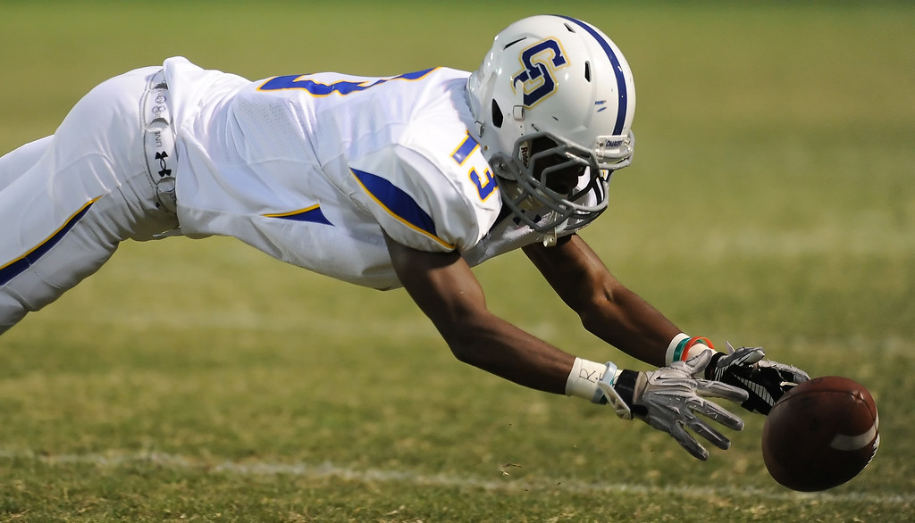 . Charter Oak\'s Dareon Nash (13) misses a catch against Bishop Amat  in the first half of a prep football game at Bishop Amat High School in La Puente, Calif. on Friday, Sept. 20, 2013.    (Photo by Keith Birmingham/Pasadena Star-News)