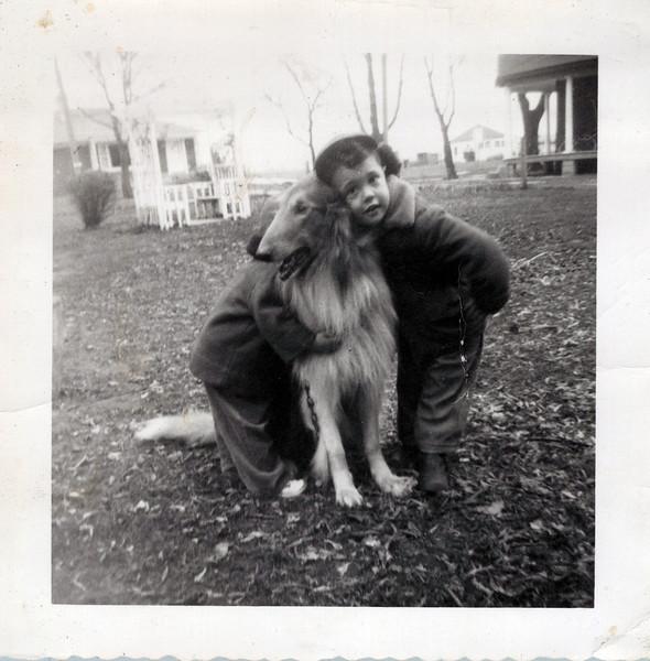 1952 Butch loving a collie.jpeg
