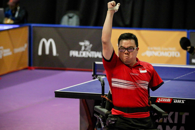 PARA TABLE TENNIS -  CHEE WENG FAI JASON  in ecstatic mood and waving at the crowd after winning in Men Individual Class 2 Round-Robin at MITEC Hall 7, KL on September 22th, 2017 (Photo by Sanketa Anand)