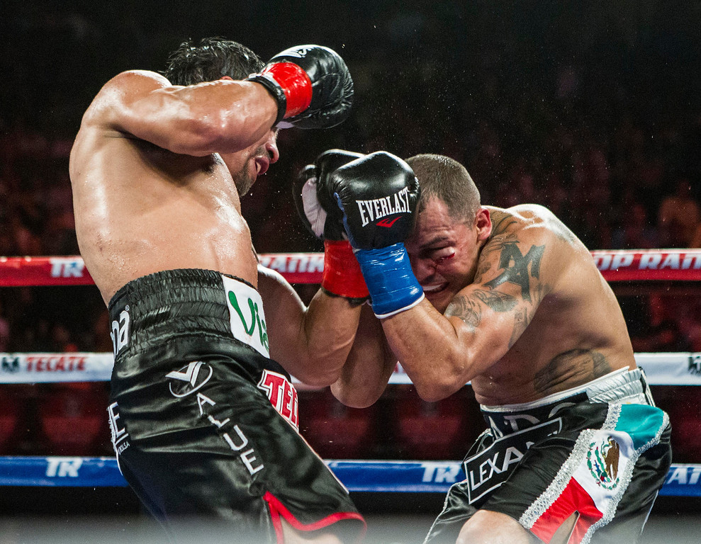 . Mike Alvarado, right, and Juan Manuel Márquez, of Mexico, exchange punches in the eleventh round of a WBO welterweight title boxing match at the Forum in Inglewood, Calif., Saturday, May 17, 2014. Márquez won the title.  (AP Photo/Ringo H.W. Chiu)