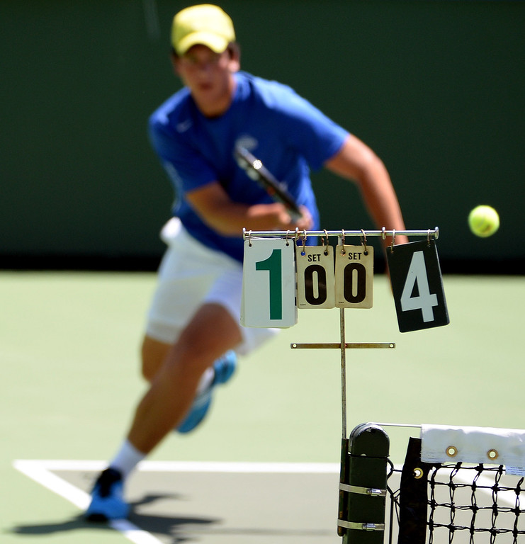 . San Marino\'s Robert Carter returns a shot against University\'s (Irvine) in a doubles match during the CIF State Tennis Championship at the Claremont Club in Claremont, Calif., on Saturday, May 31, 2014. University\'s (Irvine) won 6-2, 6-0.   (Keith Birmingham/Pasadena Star-News)