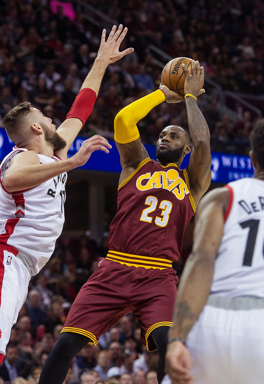 . Cleveland Cavaliers\' LeBron James (23) shoots over Toronto Raptors\' Jonas Valanciunas during the first half of an NBA basketball game in Cleveland, Tuesday, Nov. 15, 2016. The Cavaliers won 121-117. (AP Photo/Phil Long)